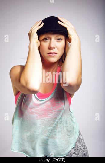 Portrait of beautiful woman dancing hip hop. Wearing fashion street wear. - Stock-Bilder