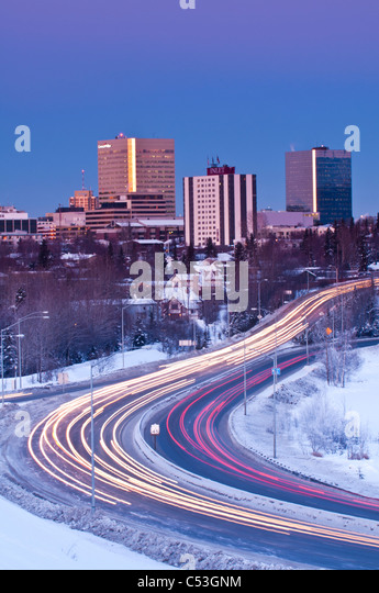 Traffic travels to and from downtown Anchorage during early evening along Minnesota Blvd., Southcentral Alaska, - Stock Image