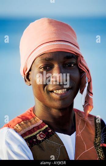 Portrait of a waiter in lodge uniform Benguerra Lodge Mozambique Model released - Stock Image