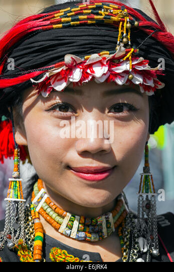 Female member of the Taiwan Contemporary Dance group, in the national costume, doing a street performance in the - Stock Image