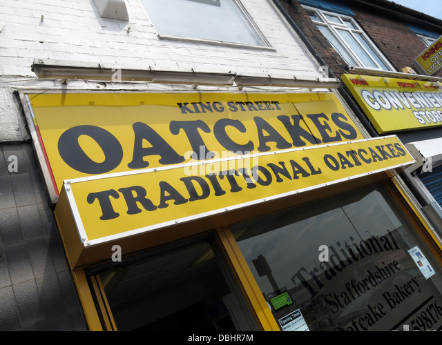 Exterior of a traditional Stoke / Staffordshire Oatcake shop, with bright yellow frontage. - Stock Image