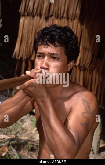 Malaysia Borneo Sarawak Kuching Cultural Village Penan tribe male blowpipe weapon - Stock Image
