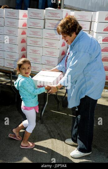 Miami Florida Alpha Omega Church Christian religion Thanksgiving turkey give-away give away free food needy volunteers - Stock Image