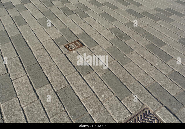 Section of street paving in City of London - metaphor for urban redevelpment, urban regeneration and infrastructure. - Stock Image