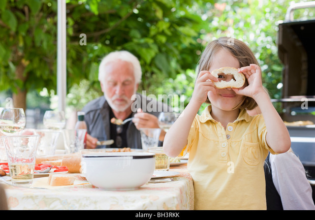 little girl with peace of bread - Stock-Bilder