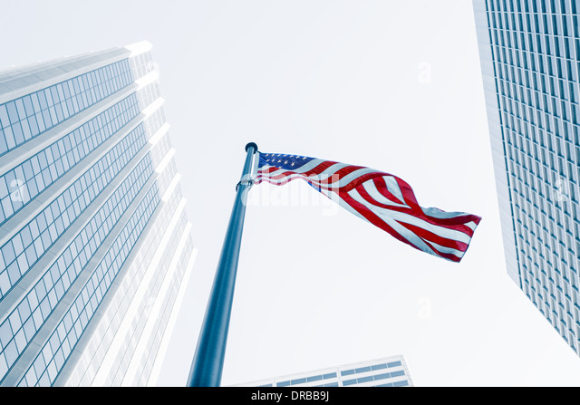 View of American flag on blue building background - Stock Image