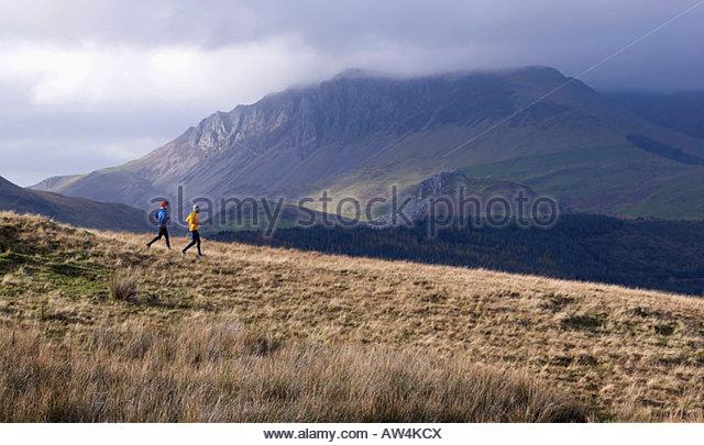 Couple running. - Stock Image