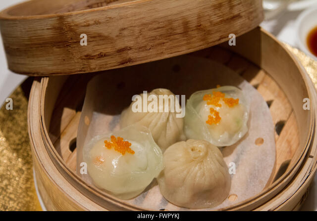 Dumpling Dim Sum served at the Shang Palace one Michelin star Cantonese restaurant at the Shangri La Hotel Paris - Stock Image