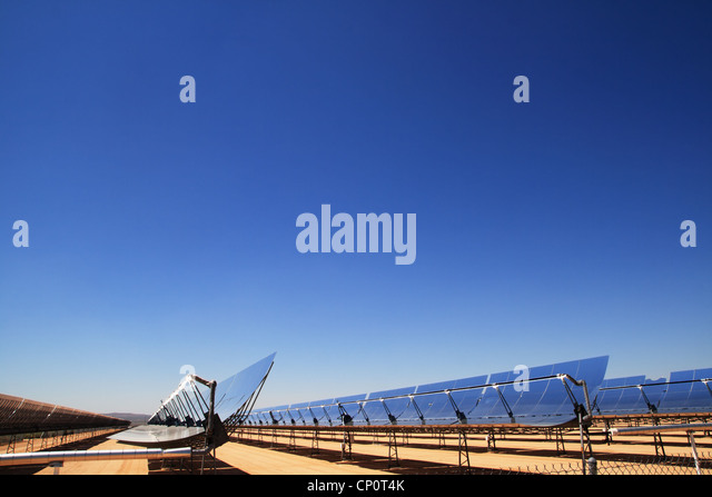 concentrated solar thermal electric energy plant mirrors with blue sky copy space above - Stock Image