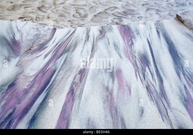 Small stream with purple sand. Big Sur Coast. California - Stock Image