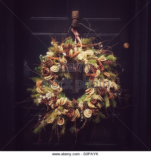 Christmas Garland on a Black Front Door - Stock Image