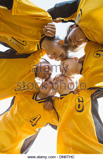 Soccer team planning game in huddle - Stock Image