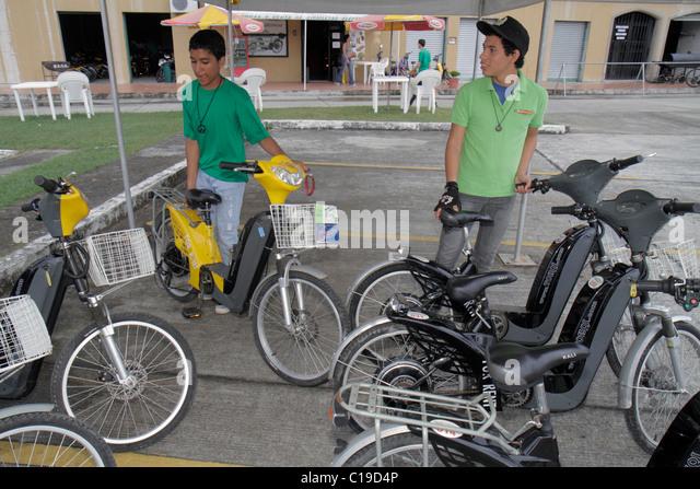 Panama City Panama Amador electric bicycle rental for rent business bike cycling alternative transportation recreation - Stock Image