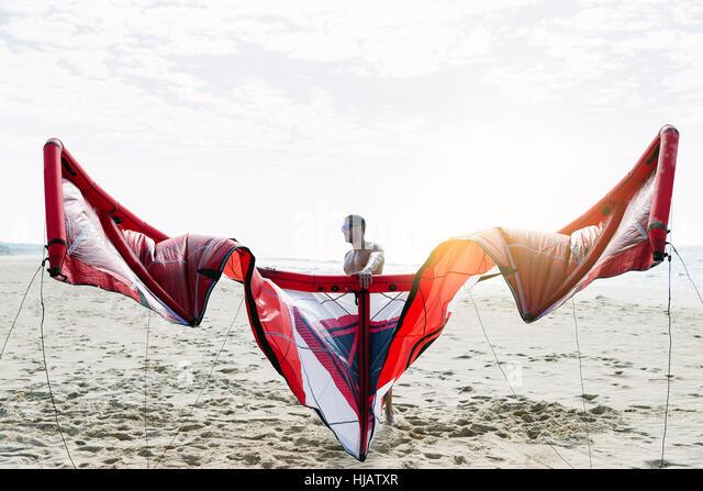 Portrait of handsome man kitesurfer in the beach. - Stock Image