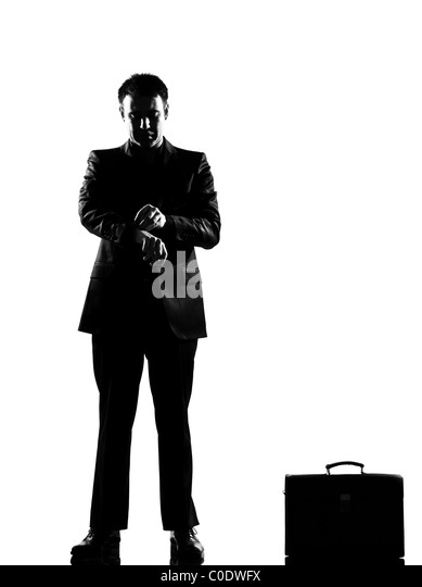 silhouette caucasian business man waiting checking the time full length on studio isolated white background - Stock Image
