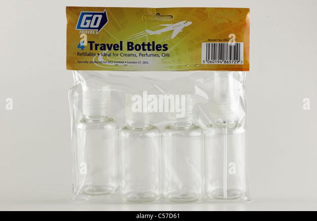 Four refillable plastic travel bottles by Go Travel - Stock-Bilder