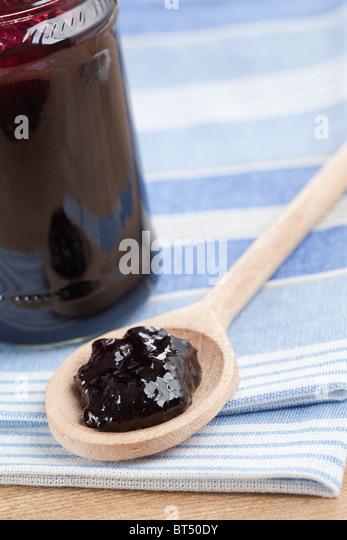 fruity jam in glass jar - Stock Image