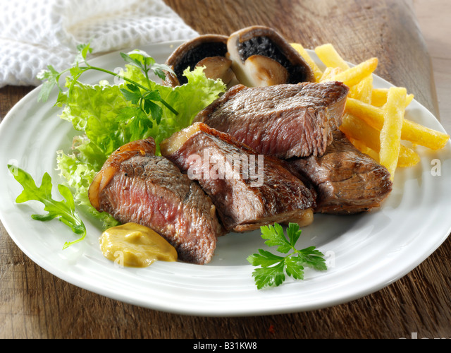 sirloin beef steak and fresh mixed salad and chips - Stock Image