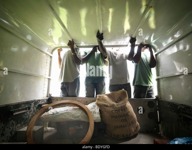 Coffee Workers In Pickup Truck - Stock Image
