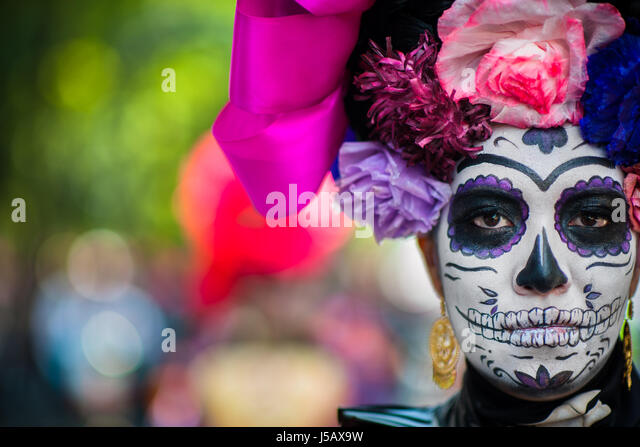 A young woman, dressed as La Catrina, takes part in the Day of the Dead celebrations in Mexico City, Mexico. - Stock Image