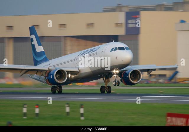 Finnair Airbus A320 landing at London Heathrow Airport - Stock Image