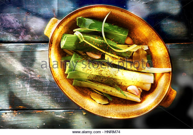 Roasted leaks with garlic ,spices,and olive oil - Stock Image