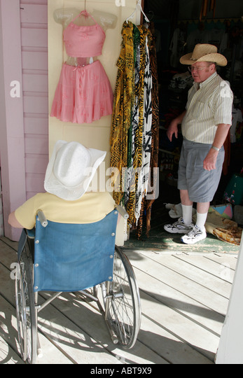 BVI Tortola Frenchmans Cay Soper's Hole Wharf and Marina wheelchair couple shopping - Stock Image
