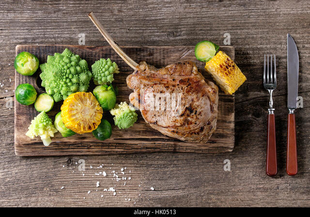 Grilled veal steak with vegetables - Stock Image