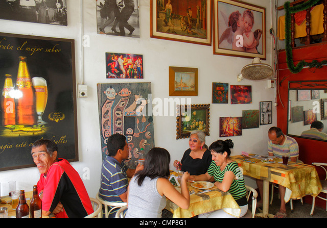 Lima Peru Barranco District Calle Colon residential neighborhood family restaurant business decor Hispanic man woman - Stock Image