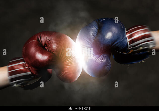 Democrats and Republicans in the campaign symbolized with Boxing Gloves - Stock Image