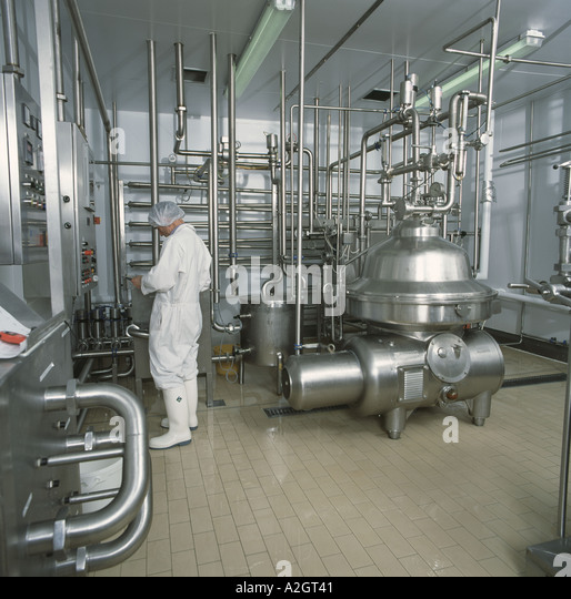 Milk processing equipment for pasteurisation and homogenization of milk at A H Warren Trust Coombe farm Somerset - Stock Image