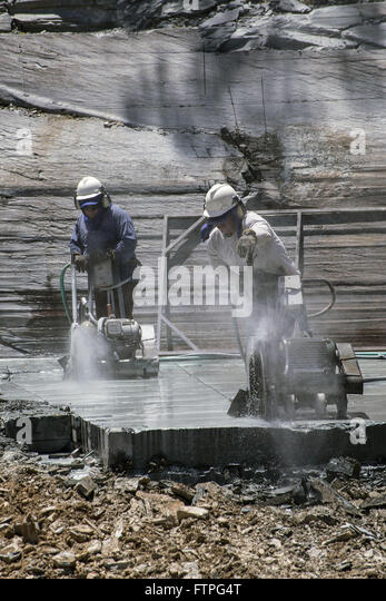 Workers cutting rock in mining digging slate - Stock Image
