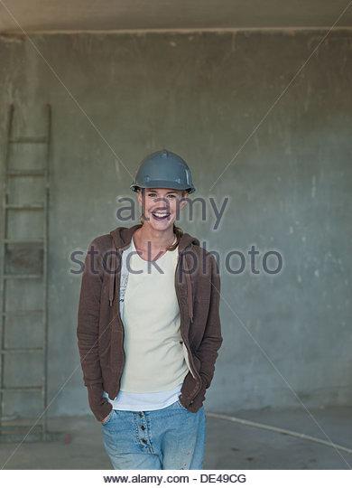 Woman in hard-hat in house under construction - Stock-Bilder