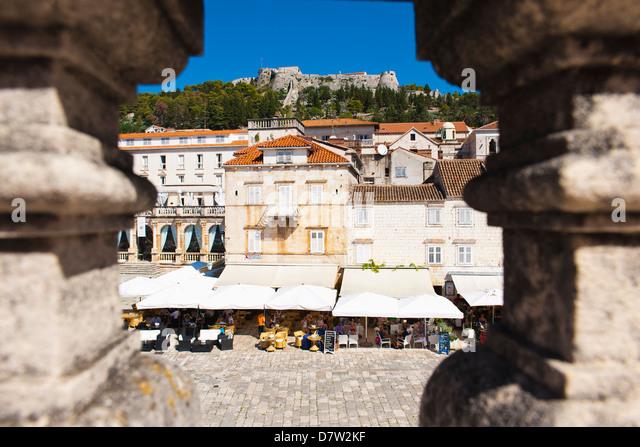 Spanish Fortress above St. Stephens Square cafes, Hvar Town, Hvar Island, Dalmatian Coast, Croatia - Stock Image