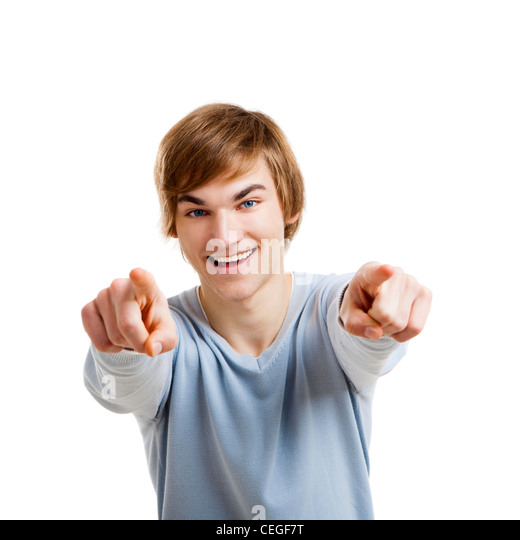 Portrait of a handsome young man looking and pointing to the camera, isolated over a white background - Stock Image