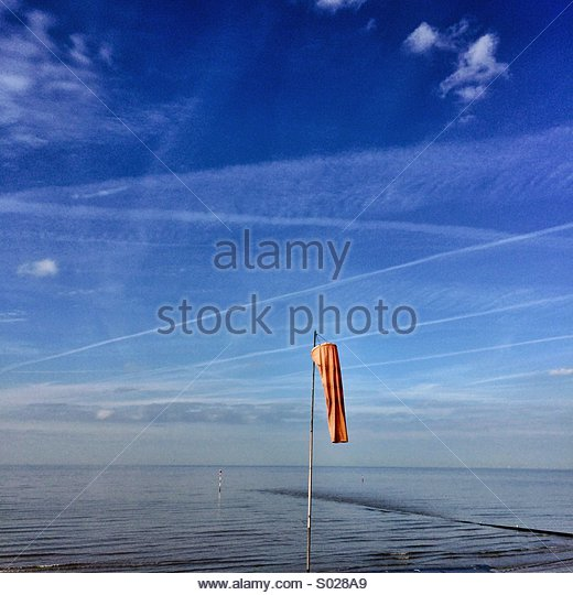 Orange Windsock Blue Sky Sea & Beach Calm - Stock Image