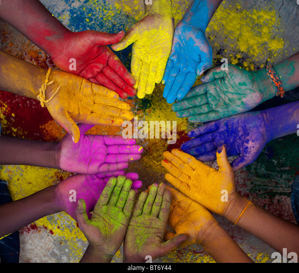 Indian boys multicoloured hands in a circle - Stock Image