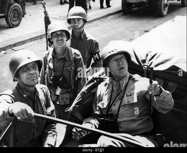 front row: General George Patton, General Theodore Roosevelt, Sicily, 1943. - Stock Image