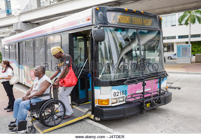 Miami Florida Omni Bus Station Metrobus public transportation mass transit bus stop electric wheelchair disabled - Stock Image