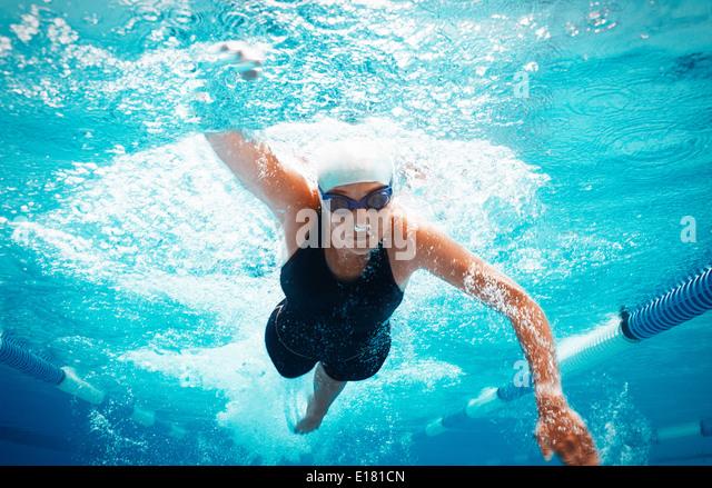 Swimmer racing in pool - Stock-Bilder