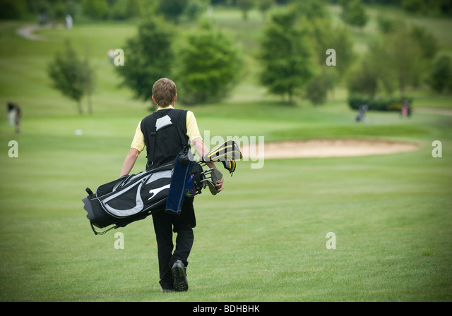 young golfer on golf course - Stock Image
