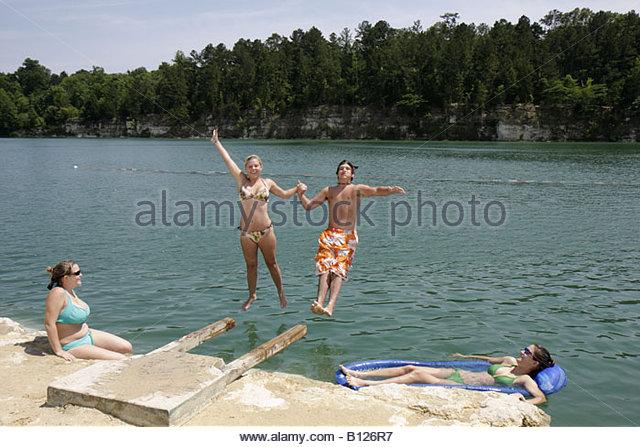 Alabama St. Stephens St. Stephens Historic Site former quarry girl boy teen dive jump swim refresh fun recreation - Stock Image