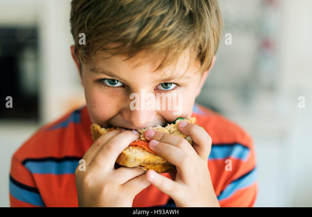 Child Children Hungry Hunger Kid Sandwich Concept - Stock Image