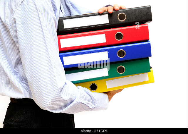 man with archival folders - Stock Image