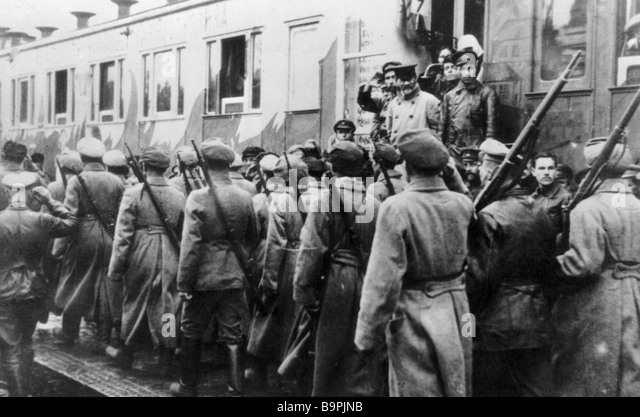 Mikhail Kalinin watches internationalist battalion march by at Gomel station - Stock Image