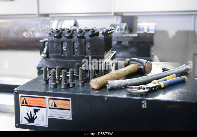 Nuts and bolts on industrial lathe - Stock Image