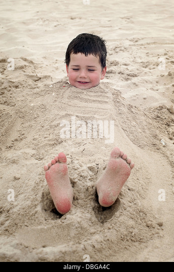 Buried in the Sand - Stock Image