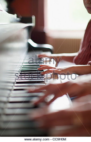 Close up of hands on piano - Stock-Bilder
