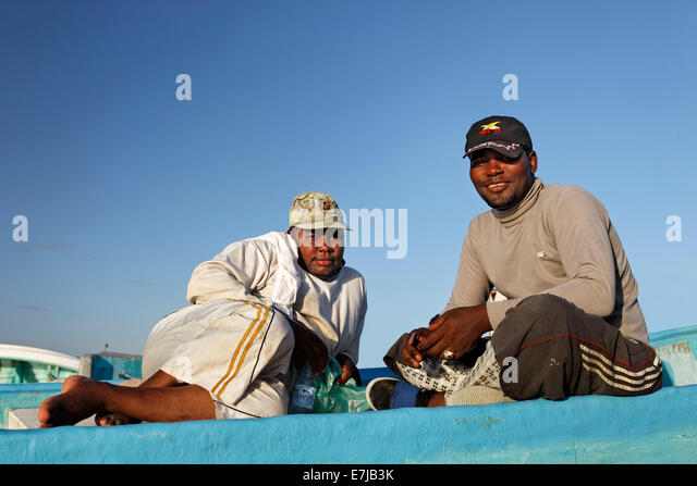 Omani fishermen on a fishing boat, Mirbat, Dhofar region, Sultanate of Oman, Arabian Peninsula - Stock Image