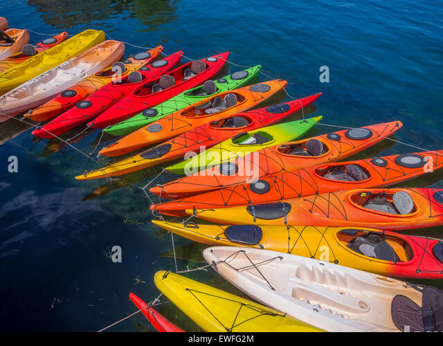 Kayaks forming a graceful arch in the waters of Rockport, MA. USA - Stock-Bilder